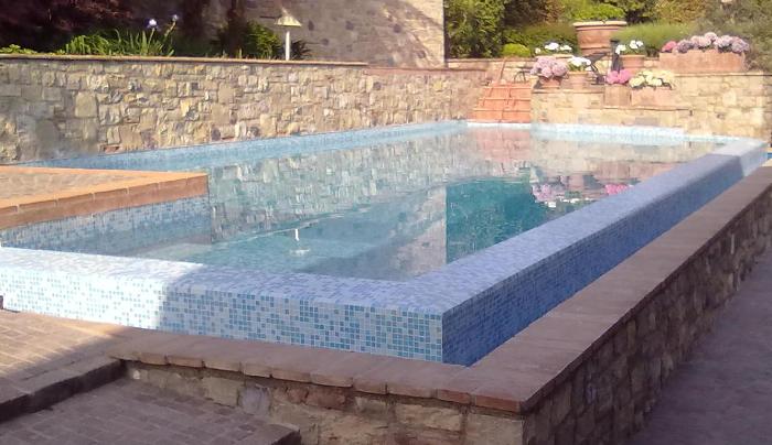 Piscine a sfioro heron piscine for Piscina con cascata