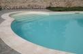 costruzione piscine Brescia forma libera skimmer sfioro