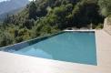 costruzione piscine sfioro rivestimento grigio
