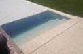 piscina sfioro a cascata su due lati appendice travertino2